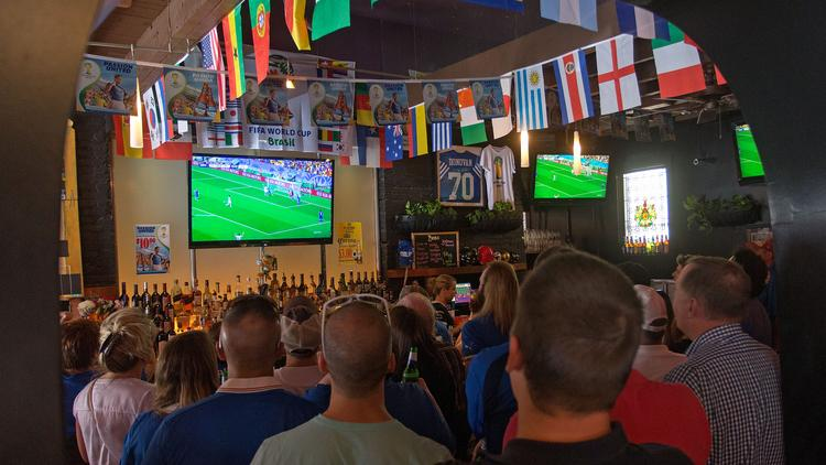 Fans pack Amicci's in Little Italy to watch Italy take on Costa Rica in the World Cup.