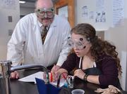 Laura Agnew, a junior at Bethlehem Central High School in suburban Albany, New York, works on a regents chemistry project with teacher Charles Reed.