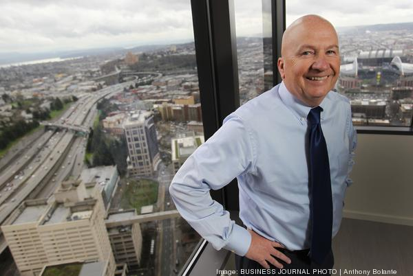 Jim Kerr, president of Davidson Companies, is pictured in his new offices in the Columbia Tower overlooking downtown Seattle as seen on March 7, 2013.
