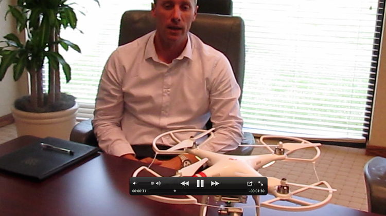 Rob Mauro, MEP Coordinator for Miamisburg-based Danis Building Construction, and the DJI Phantom 2 Vision + which his company took delivery of last week.
