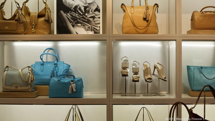 Luxury handbags and shoes are displayed for sale at a Coach Inc. store in New York.