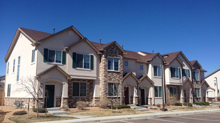 The townhouses are part of a 174-unit complex in Thornton, north of Denver.