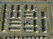 Shown is an aerial view of Sage Creek, where the buyer purchased 44 townhouses in the 174-unit complex.