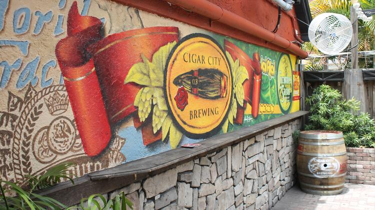 The mural at CCB Outpost features Cigar City Brewing's logo.