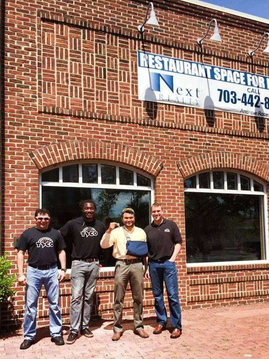 Osiris Hoil, in light shirt, with the keys to his next taco restaurant, this one in Old Town Alexandria.