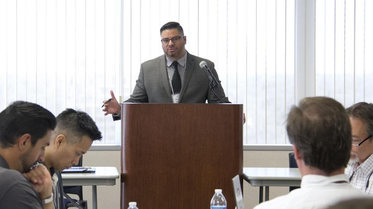 David Murillo, deputy executive director for the California Professional Association of Specialty Contractors, speaks at the association's legislative day event.