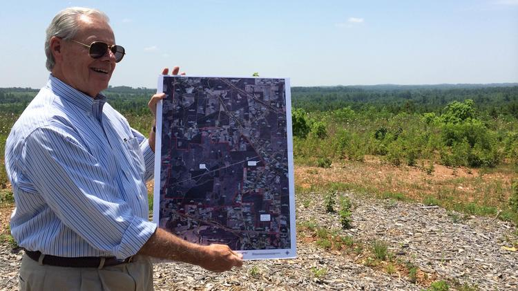 Nat Taylor of Winston-Salem firm Taylor & McChesney stands on the 1,818-acre Chatham-Randolph megasite near Siler City. The site recently received official certification from the state of North Carolina.