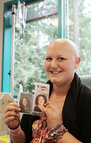 McGinn holds up photos of herself with a full head of hair before she was diagnosed with cancer.