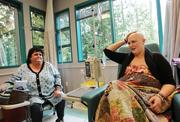 Aubrei McGinn, right, talks with her mother, Pauahi McGinn, left, who was visiting from San Bruno, Calif., during the last of Aubrei McGinn's eight chemotherapy sessions at Swedish/Edmonds. McGinn took days off work as a school teacher for treatment, but worked part- or full-time on other days. Her supervisor said McGinn was always careful to let her know about schedule changes.