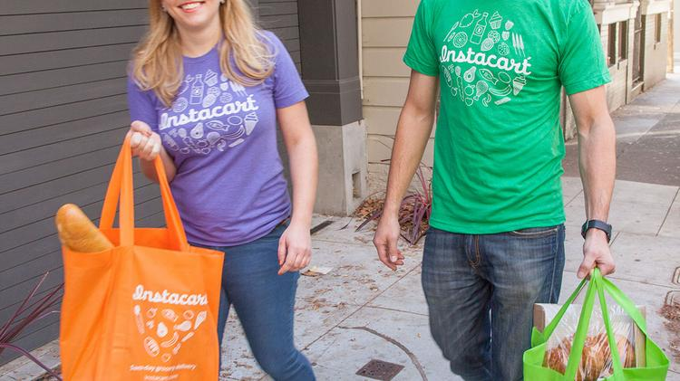 """Two Instacart """"Personal Shoppers"""" deliver groceries."""