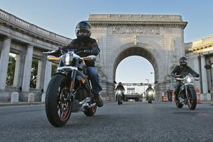 Riders introduce Project LiveWire—the first electric Harley-Davidson motorcycle—as they exit the Manhattan Bridge in New York, June 23, 2014. While not for sale, starting today select consumers across the United States will be able to ride and provide feedback on the new motorcycle during a series of events scheduled through the remainder of the year.  Ray Stubblebine/Harley-Davidson