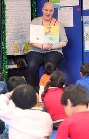 McGinn reads a book to her Early Learning Program students at Stevenson Elementary School in Bellevue.