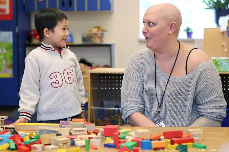 Bellevue school teacher Aubrei McGinn speaks with one of her students in the Early Learning Program at Stevenson School in Bellevue, Wash. She's a breast cancer survivor whose experience of working during her treatment is chronicled in  Puget Sound Business Journal blogs and print story.