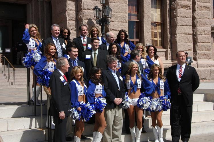 Dallas Cowboy Cheerleaders pose with lawmakers and oil and gas industry officials at the Capitol during the Texas Independent Producers and Royalty Owners Association's 67th annual convention.
