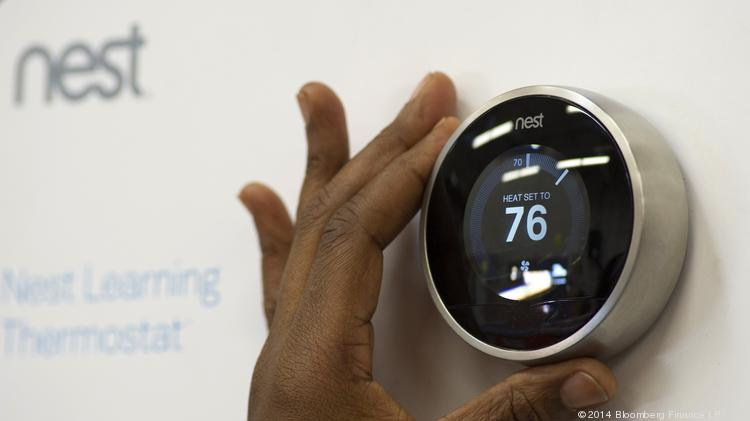 A customer checks a Nest Labs Inc. digital thermostat on display at a store.