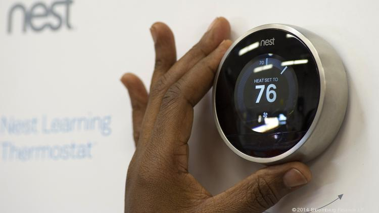 A customer checks a Nest Labs Inc. digital thermostat on display.