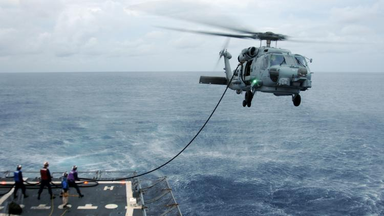 ATLANTIC OCEAN (July 31, 2013) An MH-60R Sea Hawk helicopter from the Spartans of Helicopter Maritime Strike Squadron (HSM) 70 conducts a helicopter in-flight refueling aboard the guided-missile destroyer USS Roosevelt (DDG 80). Roosevelt is participating in the George H.W. Bush group sail, further preparing the ship for the upcoming deployment. (U.S. Navy photo by Mass Communication Specialist 2nd Class Samantha Thorpe/Released) 130731-N-PI709-507 Join the conversation http://www.navy.mil/viewGallery.asp http://www.facebook.com/USNavy http://www.twitter.com/USNavy http://navylive.dodlive.mil http://pinterest.com https://plus.google.com