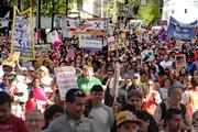 Thousands of people march down Fourth Avenue as part of the 13th Annual May Day March for Workers and Immigrant Rights.