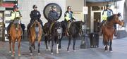 Seattle Police Department horse patrol at Westlake Park in Seattle on May Day 2013 watch a nearly empty park.