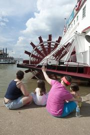 Race fans waved to the Spirit of Jefferson as it maneuvered away from the Belle of Louisville.