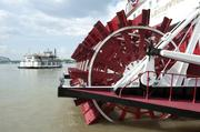 The Spirit of Jefferson pulled away from the dock. The paddle wheel of the Belle of Louisville is shown in the foreground.