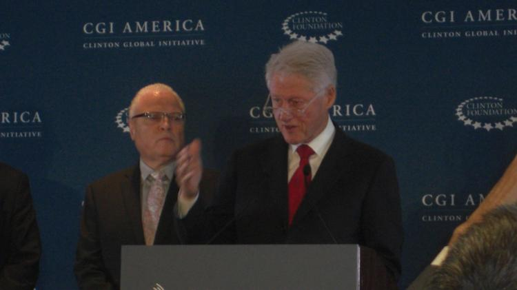 Former President Bill Clinton at the Clinton Global Initiative America forum in Denver this week. Left is Lee Saunders, president of the American Federation of State, County and Municipal Employees (AFSCME).