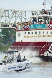 A Louisville Metro Police boat closely followed the Belle of Louisville.