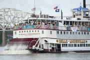 The Belle of Louisville pours on the steam as it raced up the Ohio River.