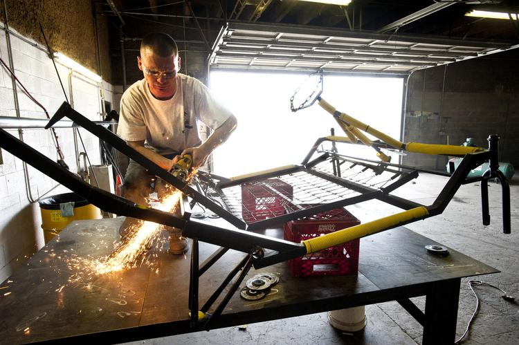 """David Mitchell, head instructor at the Knight School of Welding, worked on the frame of a """"bed"""" that would be used in the Kentucky Derby Festival Great Bed Races on Monday. The photo was taken in mid-April."""
