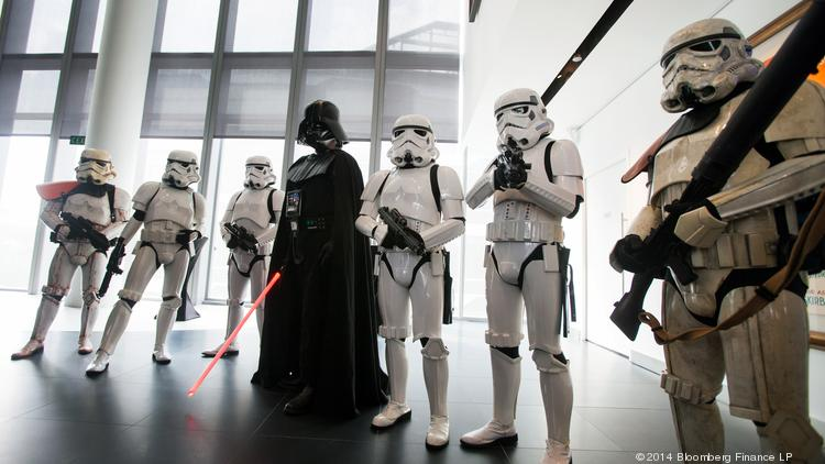 Actors dressed as Star Wars characters pose during the opening ceremony for Lucasfilm Ltd.'s Sandcrawler building in Singapore. Bay Area Star Wars fans were crushed this week when San Francisco lost filmmaker George Lucas's $700 million museum project to Chicago.