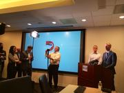 Officials await word from the GOP at the Dallas CVB offices.