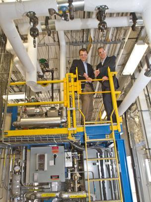 Velocys executives Jeff McDaniel, left, and CEO Roy Lipski, right, think the company's method of building gas-to-liquid conversion plants fills a need by allowing them to be constructed near remote oil and gas fields.