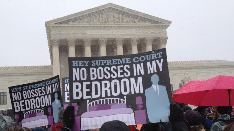 Demonstrators gathered outside the U.S. Supreme Court in March when justices heard arguments in the Hobby Lobby case.