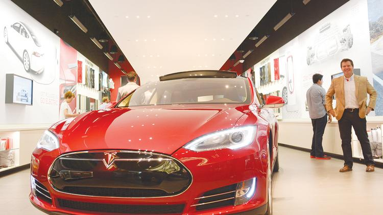 You can look at a new Tesla at the electric carmaker's NorthPark Center gallery, but you can't buy one there. Texas bans direct sales of the vehicle.