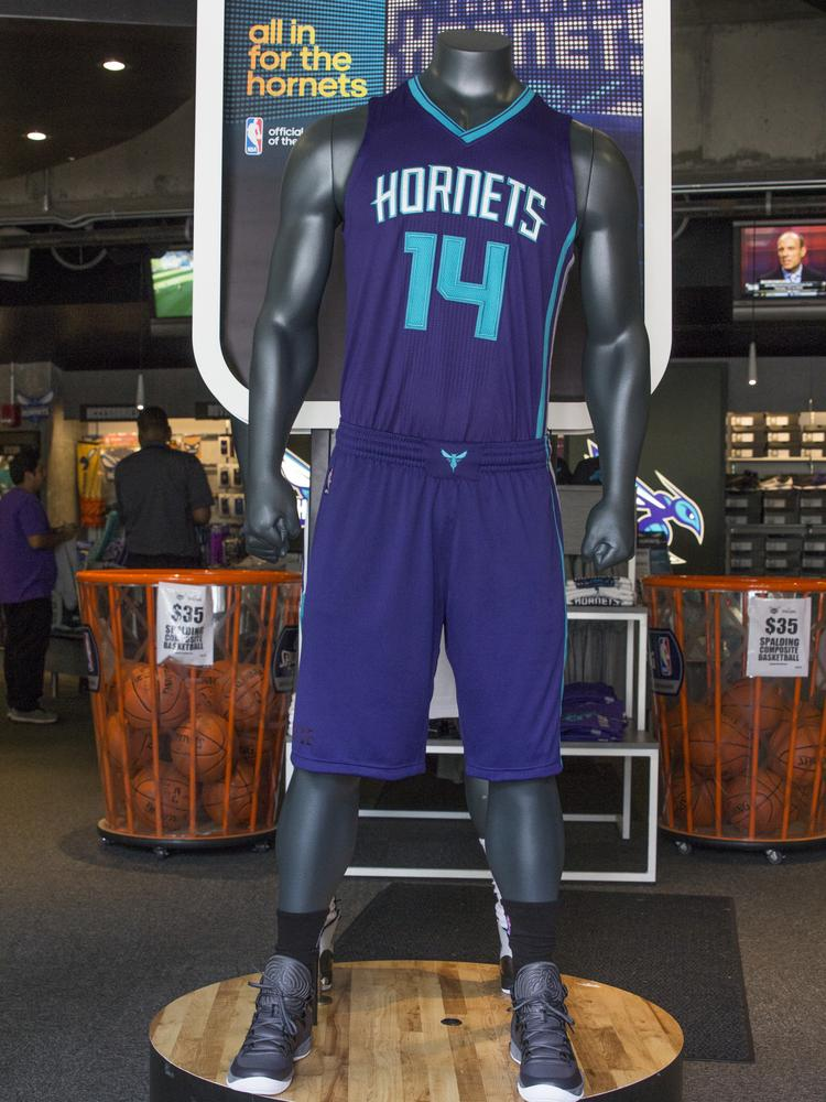 The new Charlotte Hornets uniforms, as displayed in the Hornets Fan Shop at Time Warner Cable Arena in uptown.