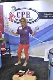 Chloe Hallberg with CPR Educators Inc. wouldn't use the defibrillator on this reporter, but she did give out plenty of bottles of water.