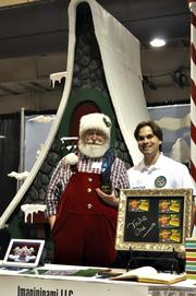"""Jarrett Saia stood with Santa and explained that the name of the company is a palindrome. Little did he know that this reporter is a bit of a palindrome whiz. Two of the reporter's favorites: """"A Santa dog lived as a devil God at NASA"""" and """"Go hang a salami, I'm a lasagna hog"""""""