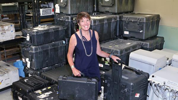 Ginny Berger likens what her firm does to a rock band on a concert tour.