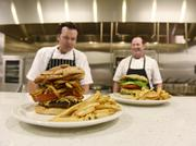 Partners Richard Keys and Zach Calkins at Food & Drink Resources make burgers for a client's consideration.