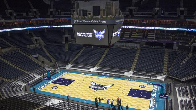 The Charlotte Hornets on Thursday revealed the new design for the court at uptown's Time Warner Cable Arena.
