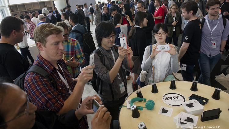 Google I/O attendees view smartphones running the latest edition of Android software during the annual tech conference in San Francisco.