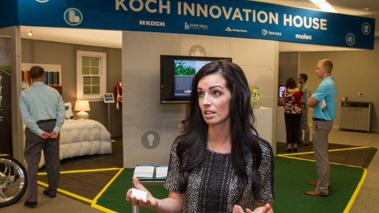 Dani Erker of Koch Industries talks outside the Koch Innovation House. The company had the exhibit on display this week inside its company headquarters. It had originally been conceived by for STEM convention earlier this year in Washington, D.C.