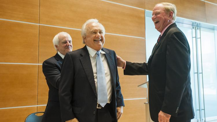 J.D. Nichols, chairman of NTS Corp., who donated $10 million to U of L gets a pat on the back from U of L president James Ramsey at today's announcement.