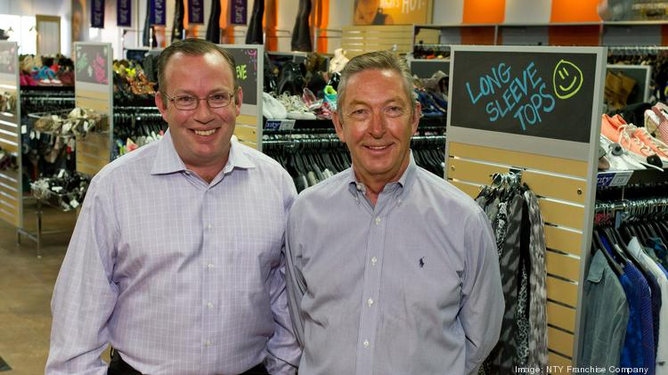 Chad Olson (left) and Ron Olson celebrate the grand opening of their NTY Clothing Exchange store in Minnetonka.