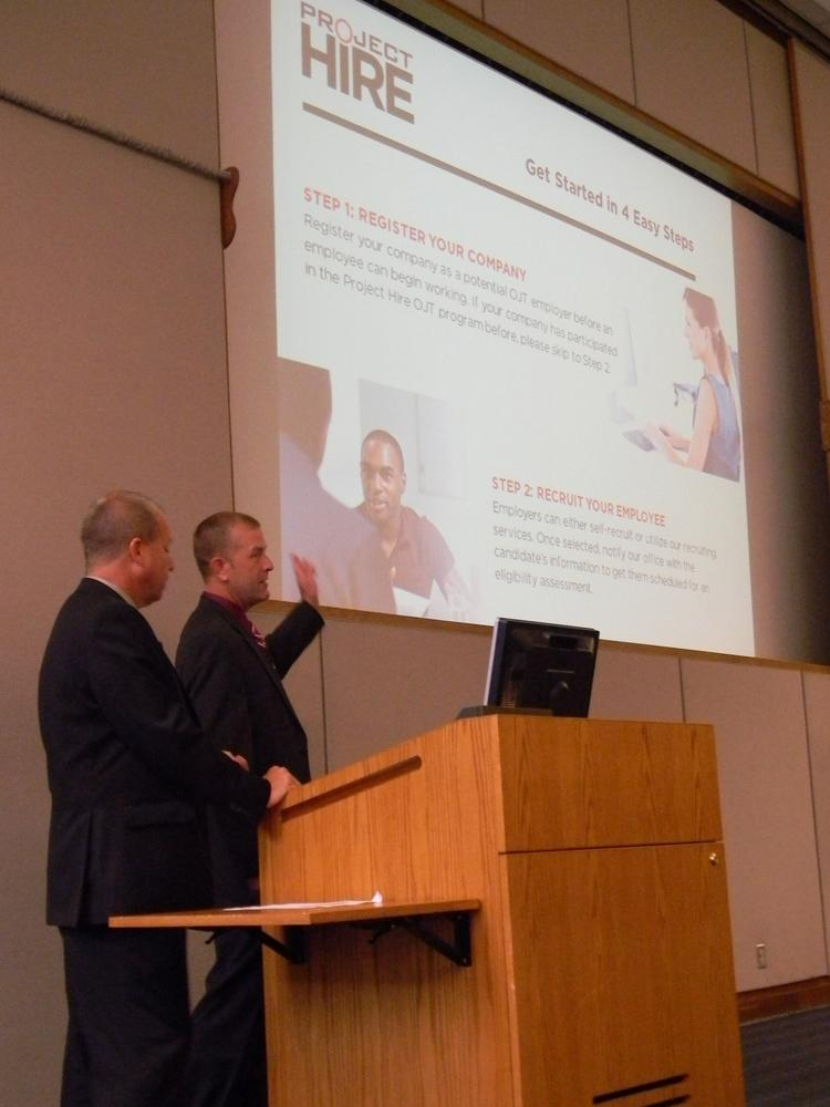Mark Anderson (left) and David Snipes (right) presented the Project Hire program to a full house at the Dayton Chamber meeting at Sinclair Community College.
