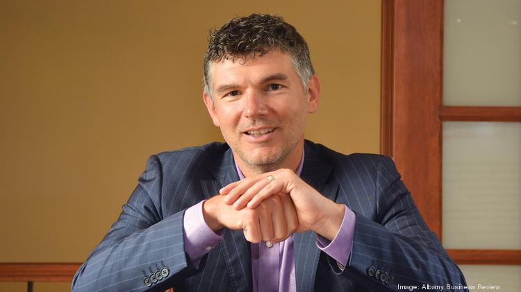 Greg Moran has spent the last few months traveling from Saratoga Springs to Dallas as he brings two companies — Chequed.com and Assess Systems — together as one as CEO.