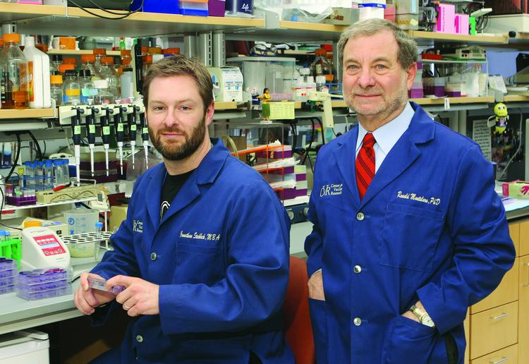 Center for Vaccine Research and Microbiology and Molecular Genetics Research Associate Jonathan Steckbeck, left, and Co-director Ronald Montelaro.