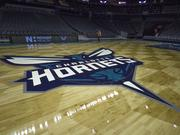 Also on Thursday, the Charlotte Hornets' new logo made its debut on the home-court floor at Time Warner Cable Arena uptown.