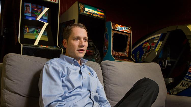 Jason Cox, chief technical officer at Cox Machine Inc., in his make-shift arcade that includes 19 consoles.
