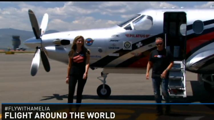 A still from 9News video of Amelia Earhart and co-pilot Shane Jordan exiting their plan in Broomfield after completing the first leg in their attempt to fly around the world.